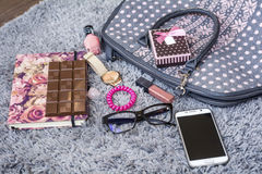 The contents of the female handbag Royalty Free Stock Photography