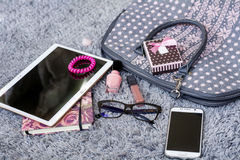 The contents of the female handbag Stock Photography