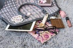 The contents of the female handbag Stock Photos