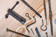 The contents of the old toolbox on light wooden background. Top Stock Photos