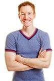 Contenuto sorridente dell'istruttore di forma fisica Fotografia Stock