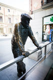 Conteporan street sculpture of a person on Calle Almudena in Mad Stock Photography