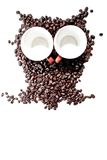 Conteptual owl made with coffee beans. And cups Royalty Free Stock Photo