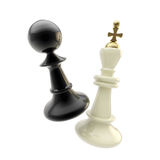 Contest and competition: pawn and king figures Stock Image