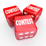 Contest Dice Word Roll Gamble Play to Win. Contest word on three red 3d dice to illustrate rolling and playing to win in a game of chance or skill to compete for Stock Photos