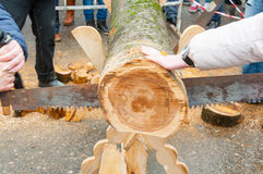 The contest of saw up the log on Maslenitsa day in Bryansk city. Stock Images