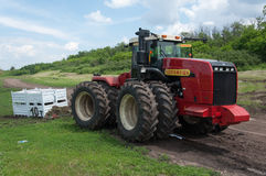 Contest of tractor drivers for towing cargo 10 tons. Races on rough terrain, take place annually at the former testing ground `Don-25`, Rostov-on-Don, Russia, At Stock Photos