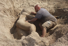 Contest winner Gary Feliciano creates sand sculpture on the Coney Island Beach during the 27th Annual Coney Island Sand Sculpting Stock Photography