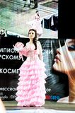 Contestant on the catwalk. Girl party open semifinal of the Championship of Russia of the city of Orenburg on hairdressing, nail modelling, design and decorative Royalty Free Stock Photos