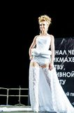 Contestant on the catwalk. Girl party open semifinal of the Championship of Russia of the city of Orenburg on hairdressing, nail modelling, design and decorative Stock Photography