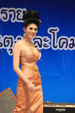 Contestant for Miss Songkran 2014. Chiangrai, Thailand - April 13, 2014: Unidentified contestant for Miss Songkran 2014 is walking on the stage for judges to Royalty Free Stock Photo