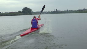 Contestant in rowing. Zabalj;Serbia; 08.03.2016.National team rowers in a kayak on the preparations for the Summer Olympic Games 2016. Video clip stock video footage