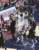A Contested Layup by Arizona Wildcat Kevin Parrom. TUCSON, ARIZONA - DECEMBER 22: MCKALE ARENA on DECEMBER 22, 2011, in TUCSON, ARIZONA. The University of Royalty Free Stock Image