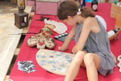 Contests and entertainment festival. folding puzzles. The child puts puzzles. soft focus. Festival on Sofyevskoy Square in the city center Kiev held inspired stock photo