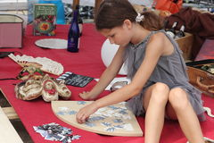 Contests and entertainment festival. folding puzzles. The child puts puzzles. soft focus. Festival on Sofyevskoy Square in the city center Kiev held inspired royalty free stock photo