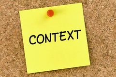 Context PostIt Note Pinned To Cork Board or corkboard. Context PostIt Note Pinned To Cork Board or cork board royalty free stock photography