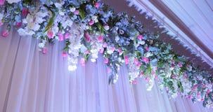 Contexto de la boda con la decoración de la flor metrajes