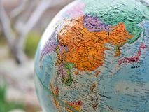 Continent of Asia focus macro shot on globe map for travel blogs, social media, website banners and backgrounds. Continent of Asia focus macro shot on globe map royalty free stock image