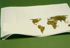 Continental Accounting Ledger. Map of the world on accounting ledger page with blank box inserted for text Stock Photo
