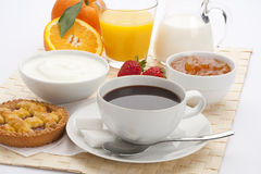 Continental breakfast. Healthy continental breakfast with coffee, fruits and sweets Royalty Free Stock Images