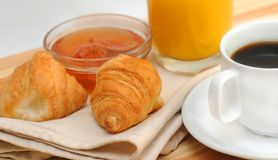 Continental breakfast. Croissant, coffee, jam and orange juice Stock Images