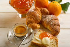 Continental breakfast. With coffee croissant marmalade and orange Stock Photo