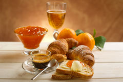 Continental breakfast. With coffee croissant marmalade and orange Royalty Free Stock Photography