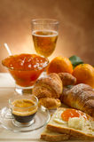 Continental breakfast. With coffee croissant marmalade and orange Royalty Free Stock Photos