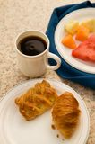 Continental Breakfast. Of coffee, pastry, and fresh fruit Royalty Free Stock Photos