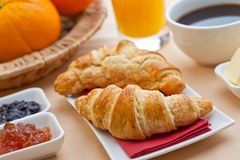 Continental breakfast. With croissant, jam, coffee and orange juice Stock Image