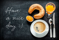 Continental breakfast on black chalkboard. Have a nice day poster design with continental breakfast on black chalkboard background. Bar morning menu - coffee Stock Photo