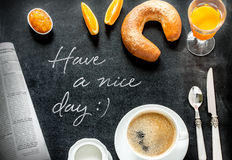 Continental breakfast on black chalkboard stock photo