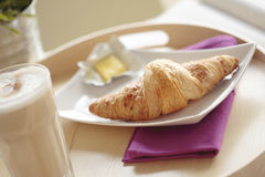 Continental Breakfast with Coffee and Croissant Stock Image