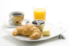 Continental breakfast of coffee and croissants Royalty Free Stock Photography