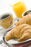 Continental breakfast of coffee and croissants Royalty Free Stock Photos