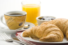 Continental breakfast of coffee and croissants Royalty Free Stock Images