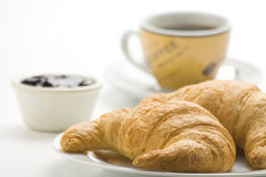 Continental breakfast of coffee and croissants Royalty Free Stock Image
