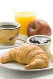 Continental breakfast of coffee and croissants Stock Images