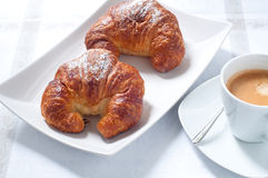 Continental breakfast with coffee , croissants and fresh fruit Stock Photos