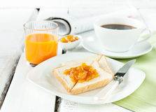 Continental breakfast - coffee, orange juice, toast stock photos