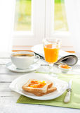 Continental breakfast - coffee, orange juice, toast Stock Image