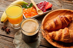 Continental breakfast croissant coffe orange juice Royalty Free Stock Images