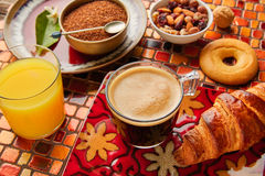 Continental breakfast croissant coffe orange juice Stock Photos