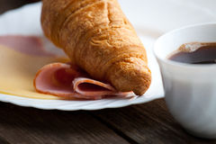 Continental breakfast with croissant and coffee Stock Photos