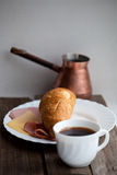 Continental breakfast with croissant and coffee, soft focus Stock Photo