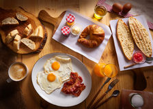 Continental breakfast croissant eggs bacon bread Stock Image