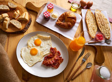 Continental breakfast croissant eggs bacon bread Royalty Free Stock Images
