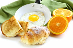 Continental breakfast - croissant, fried egg, toast Stock Photo
