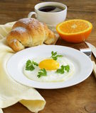 Continental breakfast - croissant, fried egg, toast Royalty Free Stock Photo