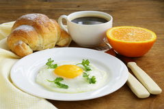 Continental breakfast - croissant, fried egg, toast Stock Images
